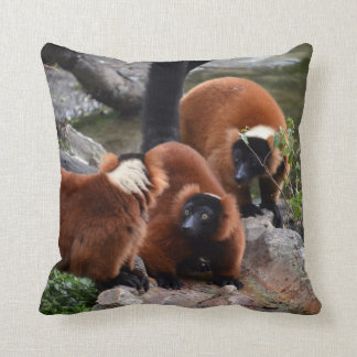 group of red ruffed lemur looking center throw pillow