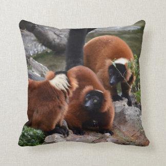 group of red ruffed lemur looking center throw pillow