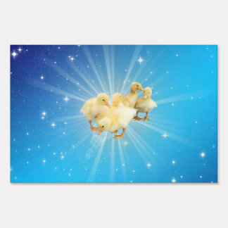 Group of small cute ducks on a blue sky with stars lawn sign