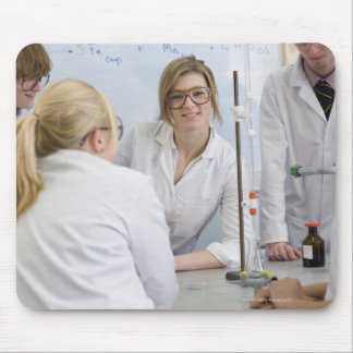 Group of students wearing lab coats and safety 2 mouse pad