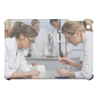 Group of students wearing lab coats and safety iPad mini cases