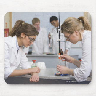 Group of students wearing lab coats and safety mouse pad