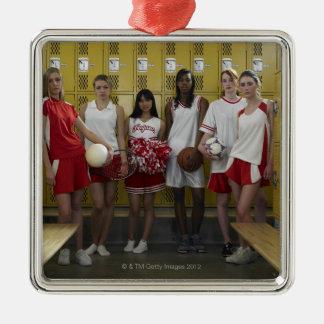 Group of teenage girls (15-17) standing in metal ornament