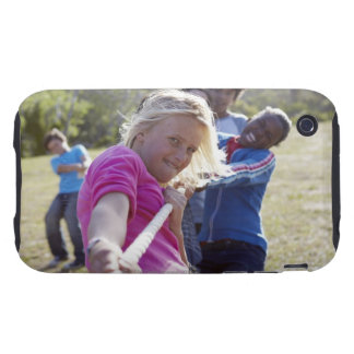 Group of teenagers, aged 13,  pulling together tough iPhone 3 cover