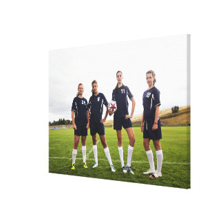group portait of teen girl soccer players canvas print
