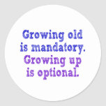 Growing old is mandatory classic round sticker