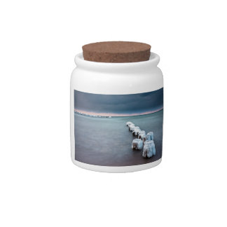 Groyne in winter on shore of the Baltic Sea Candy Jar