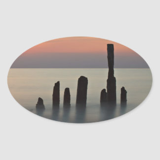 Groynes and sunset on the Baltic Sea coast Oval Sticker