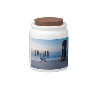 Groynes at night on shore of the Baltic Sea Candy Jar