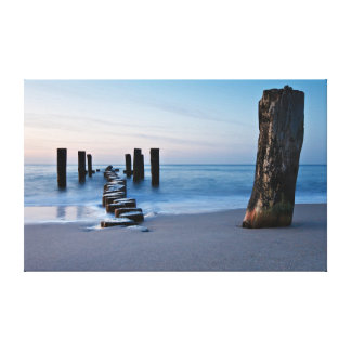 Groynes at night on shore of the Baltic Sea Canvas Print