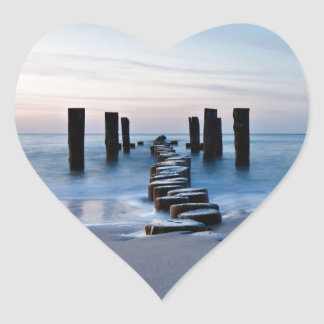 Groynes at night on shore of the Baltic Sea Heart Sticker