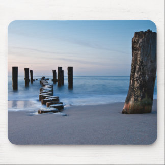 Groynes at night on shore of the Baltic Sea Mouse Pad