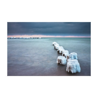 Groynes in winter on shore of the Baltic Sea Canvas Print