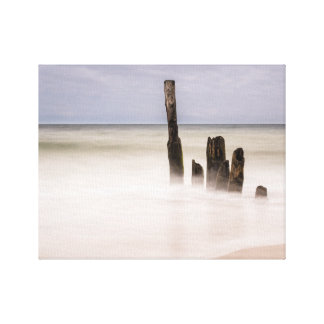 Groynes on shore of the Baltic Sea Canvas Print