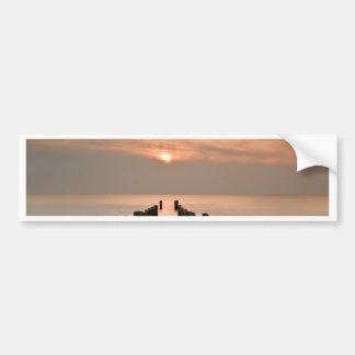 Groynes with sunset bumper sticker