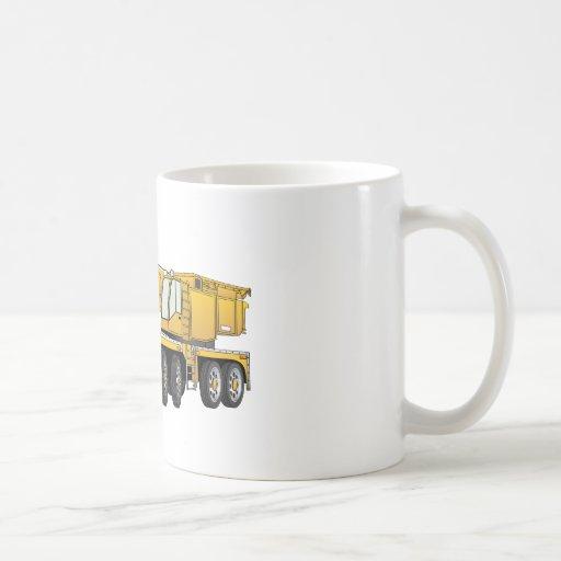 Grúa amarilla corta del dibujo animado tazas