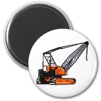 Grúa de construcción anaranjada imán redondo 5 cm