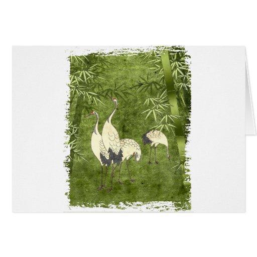Grúas en el bosque de bambú tarjetón