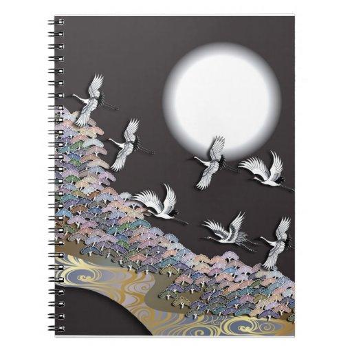 Grúas, luna y pinos notebook