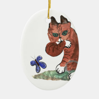 Grumpy Paws Eyes an Etheral Butterfly Ornament