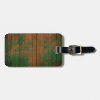 grundgy worn wood background bag tag