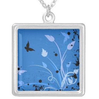 Grunge azul de la mariposa colgante cuadrado