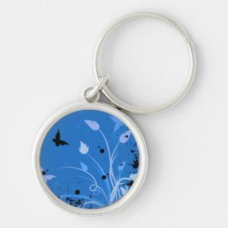 Grunge azul de la mariposa llavero redondo plateado