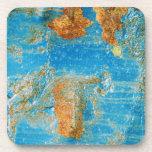 Grunge azul oxidado del acero del metal posavasos