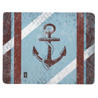 Grunge azul rojo del ancla náutica retra apenado