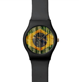Grunge Brazilian flag on rustic board background Wristwatches