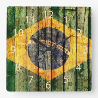 Grunge Brazilian flag on rustic wood background Square Wall Clock