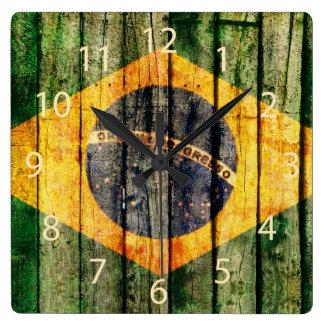 Grunge Brazilian flag on rustic wood background Square Wallclocks