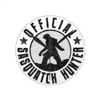 Grunge Cool Sasquatch Bigfoot Hunter. Round Wallclocks