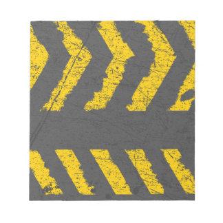 Grunge distressed yellow road marking notepad