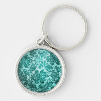 Grunge filigree pattern in teal. keychains