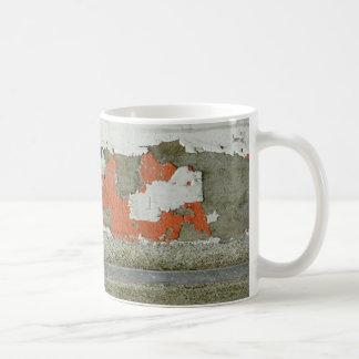 Grunge peeling orange paint on concrete wall coffee mug
