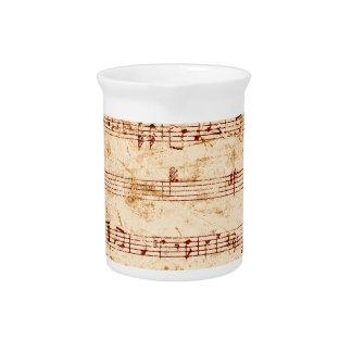 Grunge piano notes music sheet beverage pitchers