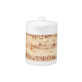 Grunge piano notes music sheet teapot