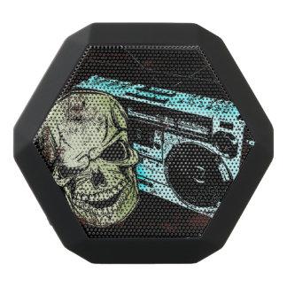 Grunge skull listening to a retro 80s boom box… black bluetooth speaker