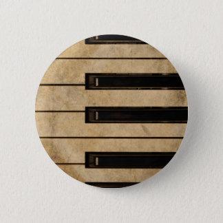 Grunge vintage piano button