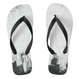 Grungy city background in black and white flip flops