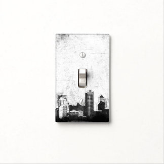 Grungy city background in black and white light switch covers