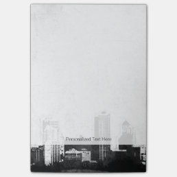Grungy city background in black and white post-it notes