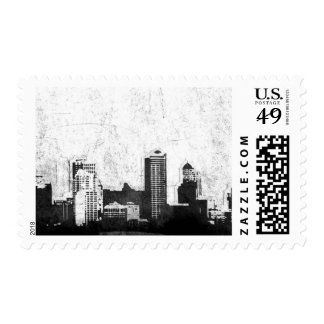 Grungy city background in black and white stamp