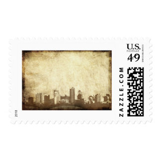 Grungy city background postage stamp