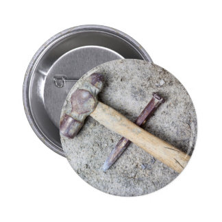 Grungy hammer and chisel pinback button