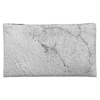 Grungy white stucco wall background cosmetic bag