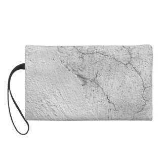 Grungy white stucco wall background wristlet purse
