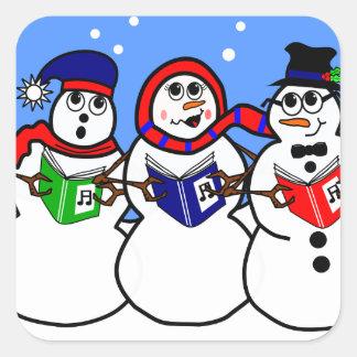 Grupo cantante del muñeco de nieve del dibujo pegatina cuadrada
