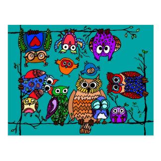 Grupo de búhos del dibujo animado postal